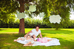 Grandmother with sleeping grandchildren in park Royalty Free Stock Photography