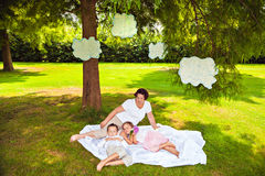 Grandmother with sleeping grandchildren under clouds Stock Image
