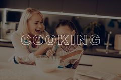 Woman Smeared Girl`s Nose. Happy Family Cooking. Grandmother Smeared Girl`s Nose. Happy Family Cooking. Happy Family Have Fan. Grandmother Help Girl. Little stock photos