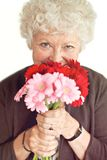 Grandmother Smelling the Flowers Royalty Free Stock Photo