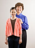 Grandmother standing with granddaughter Stock Photography