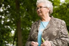 Grandmother standing outside looking stock photography