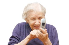 Grandmother studies phone Royalty Free Stock Photography
