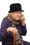 Grandmother talking with a mobile phone Royalty Free Stock Image