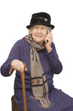 Grandmother talking with a phone Stock Photography
