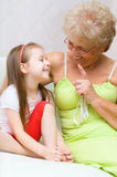 Grandmother talking to her granddaughter Royalty Free Stock Photos