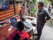 Grandmother talking to her granddaughter through Skype at Luang Stock Photography