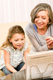 Grandmother teach young girl learn music notes Royalty Free Stock Images