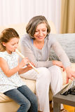 Grandmother teach young girl play flute happy Stock Photos