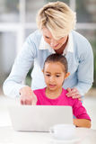 Grandmother teaching grandchild computer Royalty Free Stock Photography