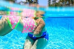 Grandmother teaching granddaughter to swim Stock Images