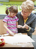 Grandmother teaching her granddaughter cooking Royalty Free Stock Photo