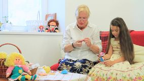 Grandmother Teaching Her Granddaughter stock video