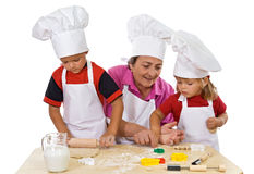 Grandmother teaching kids making cookies Royalty Free Stock Photo