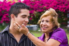 Grandmother with teen boy. Grandmother caressing teen boy grandson stock image