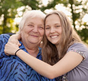 Two of Kind. Grandmother and teenager girl Granddaughter royalty free stock photos