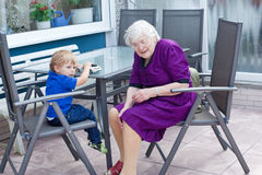 Grandmother and toddler boy  in summer Royalty Free Stock Photo