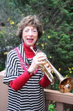 Grandmother trumpet player. Royalty Free Stock Photos