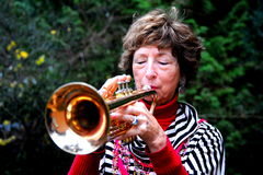 Grandmother trumpet player. Stock Photography