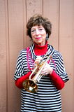 Grandmother trumpet player. Royalty Free Stock Image