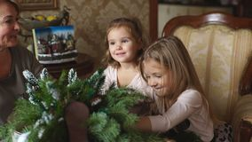 Grandmother with two childs preparing for Christmas stock video footage