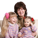 Grandmother and two granddaughter. Royalty Free Stock Photos
