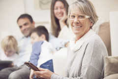 Grandmother using mobile phone Royalty Free Stock Photography