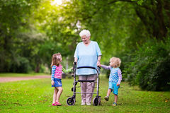 Grandmother with walker playing with two kids Royalty Free Stock Photos