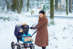 Grandmother walking with baby boy  in winter Stock Photos