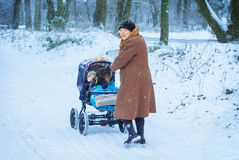 Grandmother walking with baby boy  in winter Stock Image