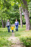 Grandmother is walking with her grandchildren. In the park royalty free stock photography