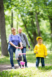Grandmother is walking with her grandchildren. In the park Stock Images
