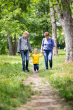 Grandmother is walking with her grandchildren. In the park stock photography