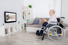 Grandmother Watching Movie On Television royalty free stock image