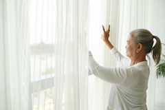 Grandmother by window Royalty Free Stock Photography