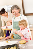 Grandmother With Little Girl Prepare Dough Royalty Free Stock Image