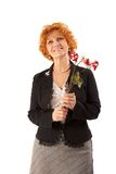 Grandmother with withered flowers. Royalty Free Stock Image