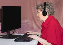 Grandmother in the modern world. Not a day without the Internet royalty free stock image