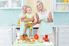 Grandmother the young girl and the small child. stock images