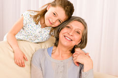 Grandmother with young girl smile relax together Stock Image