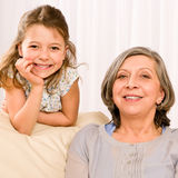 Grandmother with young girl smile relax together Royalty Free Stock Image
