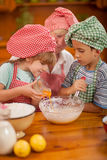 Grandmother with young kids In Kitchen Royalty Free Stock Photos