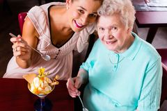 Grandmother and young woman eating ice cream Stock Image