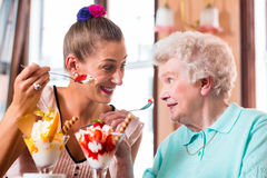 Grandmother and young woman eating ice cream Royalty Free Stock Photography