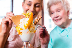 Grandmother and young woman eating ice cream Royalty Free Stock Photo