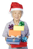 Grandmother1. My grandmother happy smiling receiving a christmas gift Royalty Free Stock Image