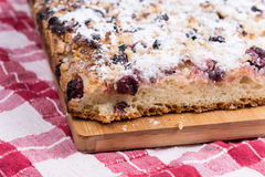 Grandmothers cake with cherries on the wooden board Stock Photos