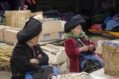Grandmothers market Sin Ho. Two grandmothers Dao ethnic black market Sin Ho. North Vietnam. One sells fresh peanuts, the other of rice vermicelli. They have for Stock Image