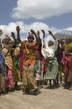 Grandmothers, who are the caretakers of their children and grandchildren who are infected with HIV/AIDS, dance at Pepo La Tumaini  Royalty Free Stock Images