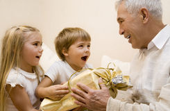 Grandpa 2. Children make a present to their grandpa royalty free stock images